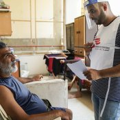Mounir Othman was home with his two children when the explosion happened. The blast projected him in the air and his hand was injured. Mounir received a visit from the MSF team taking part in door-to-door activities in Karantina. © Mohamad Cheblak/MSF