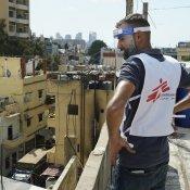 An MSF team member looks over the neighbourhood of Karantina, east of the Port of Beirut, during door-to-door activities. © Mohamad Cheblak/MSF